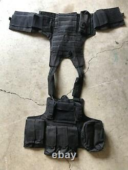Black Tactical Vest Plate carrier with 2 Curved 10x12 Plates & Pouches Included